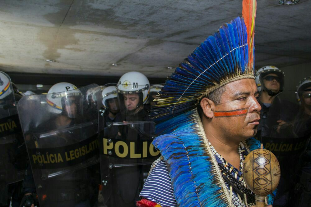 Native activists in Brazil protest land bill with bows and arrows