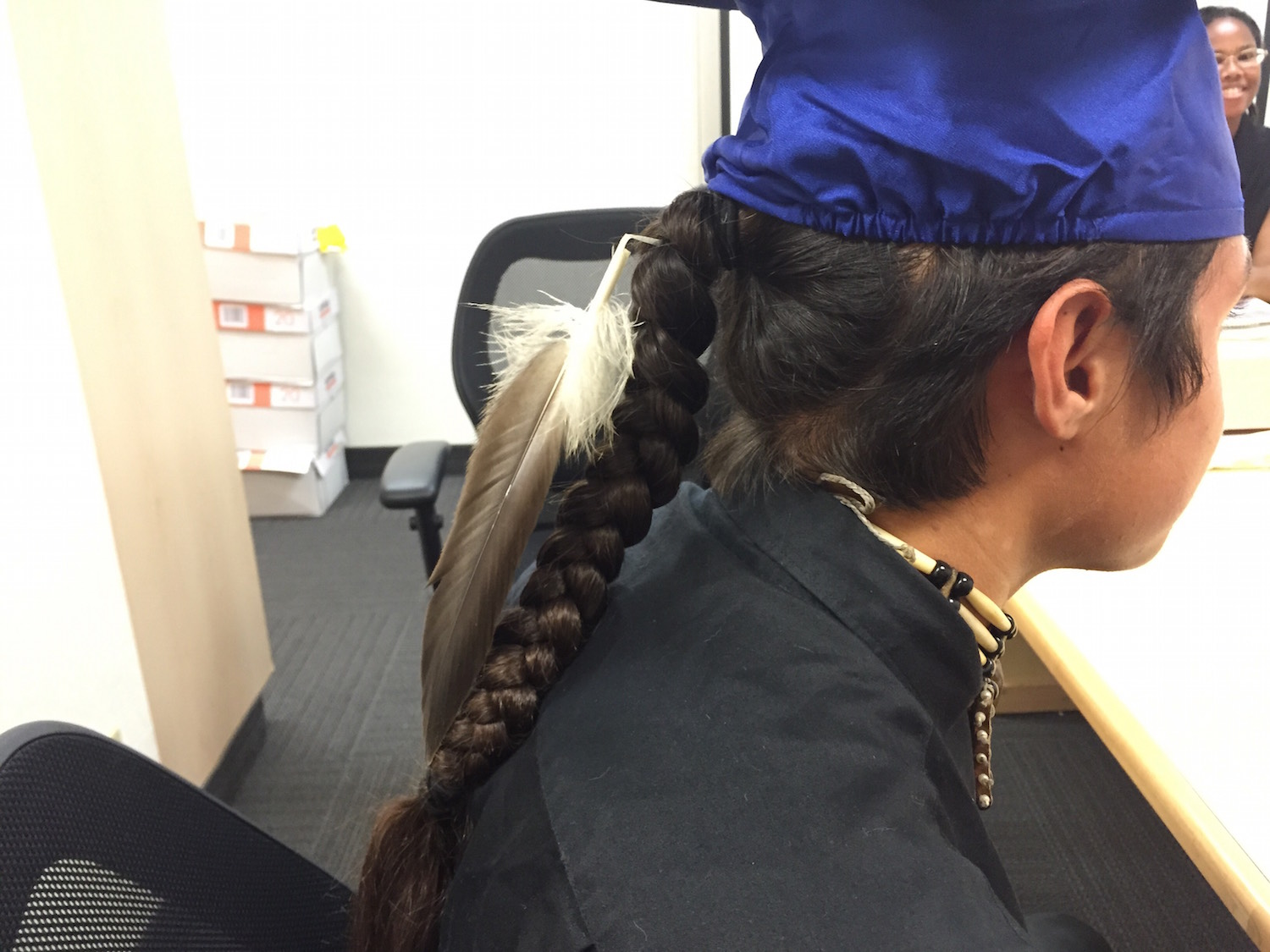 Student from Pit River Tribe graduates with eagle feather in cap