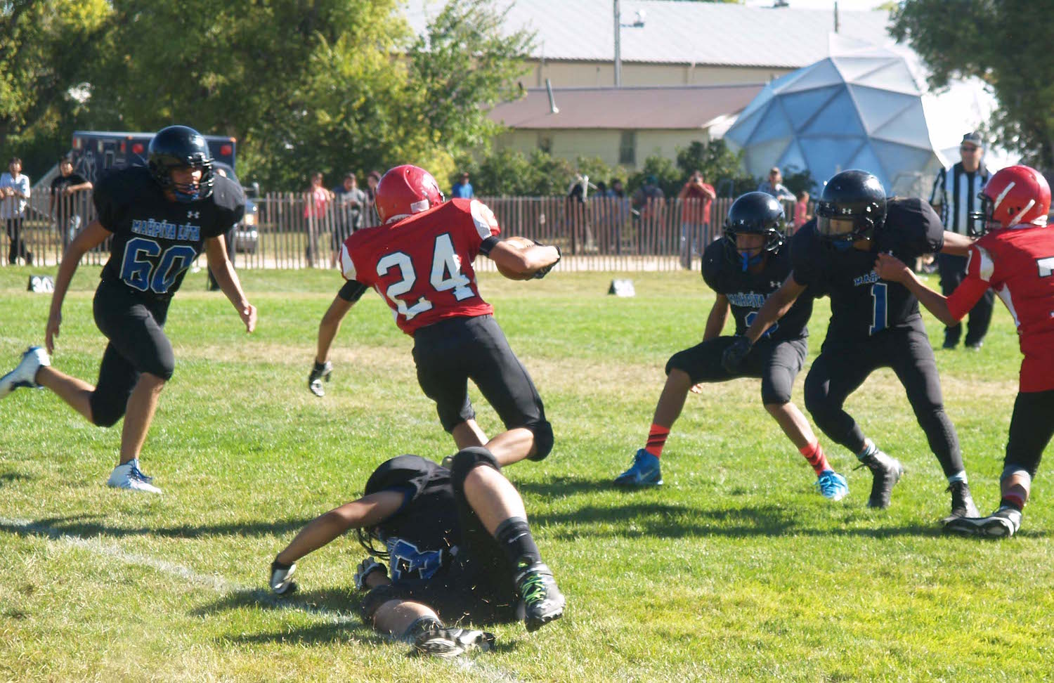 Native Sun News: Rival teams meet on football field at Pine Ridge