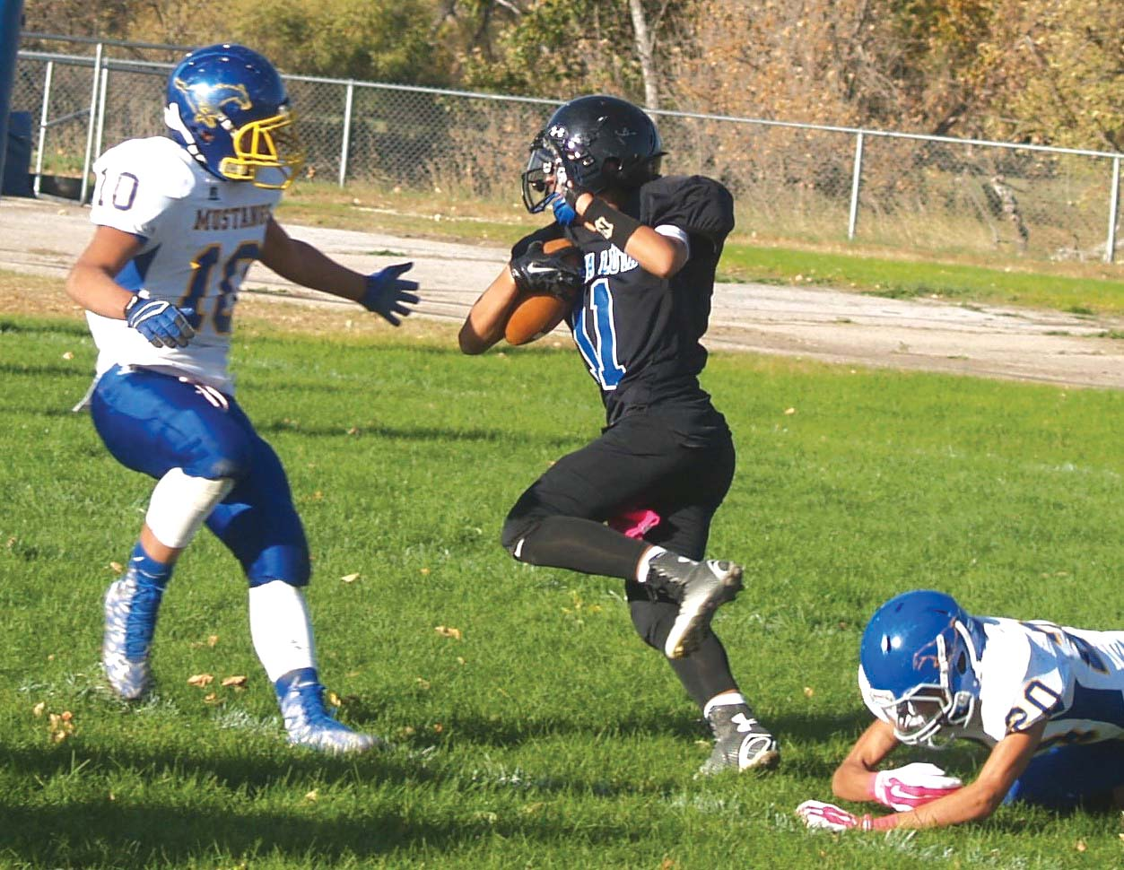 Native Sun News: Pine Ridge football teams battle in 'ugly' game