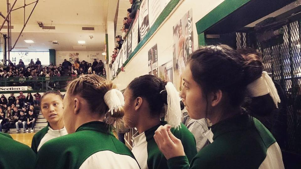 Girls basketball team proudly wears Navajo hairstyle during game