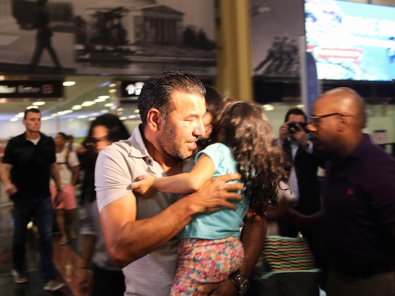 'I never thought I would see her again': Children reunited with migrant family